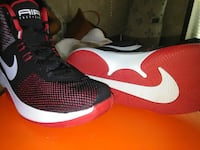 pair of red-black-and-white Nike Air basketball shoes