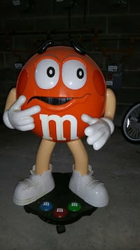 orange m&m ceramic figurine