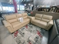Beige leather sectional sofa with throw pillows Brampton, L6T 1A2
