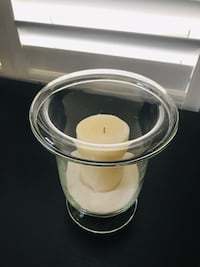 Candle in a vase with sand