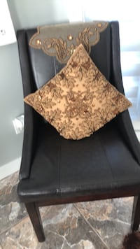 black leather padded chair with brown floral throw pillow Edmonton, T5Z 3T7