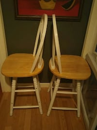 two white-and-brown wooden windsor chairs London, N6E 1Z3