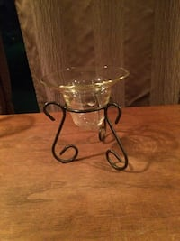 Clear glass candle holder with black metal stand