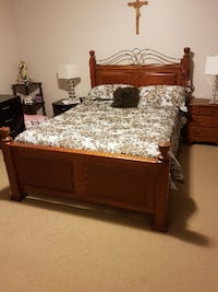 brown wooden bed frame with white and brown floral mattress Kitchener