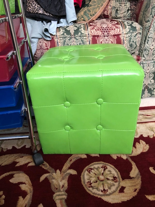 green leather padded chair with stainless steel frame