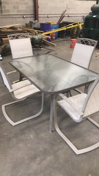 rectangular glass top table with four chairs patio set Linthicum Heights, 21090