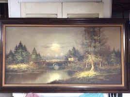 House in the middle of forest painting, wood frame.
