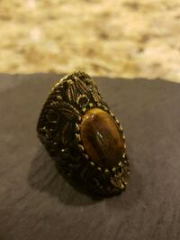 gold-colored and black gemstone ring Gaithersburg, 20879