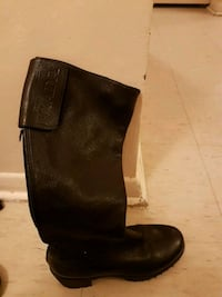 unpaired black leather round toe knee-high boot Toronto