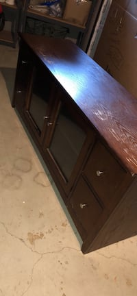 Entertainment center, brown, 4 drawers, 2 glass windows. Great condition, available now. Hudsonville, 49426