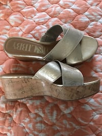 pair of gray leather sandals 1366 mi