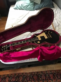 black and pink electric guitar with case 384 mi