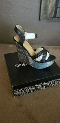 pair of black leather open-toe wedges Amarillo