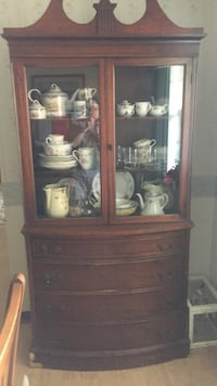 brown wooden display cabinet Ocala, 34471