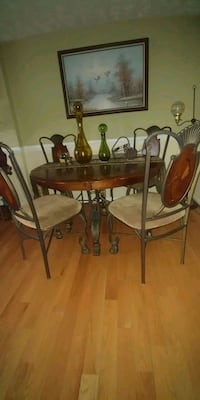 round brown wooden table with four chairs dining set Falls Church, 22043
