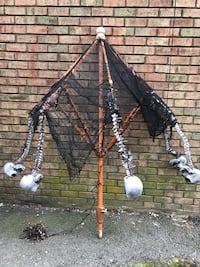 Halloween decoration. Half umbrella w/skulls & lights