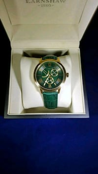 round silver chronograph watch with green leather strap Wilmington, 19805