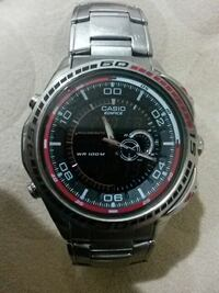 silver black and red casio chronograph watch