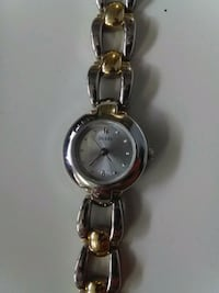 round silver analog watch with silver link bracelet Calgary, T2H 0G3