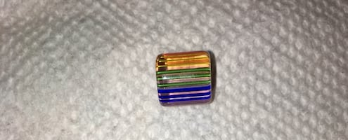 orange, green, and blue stone charm. Radiant
