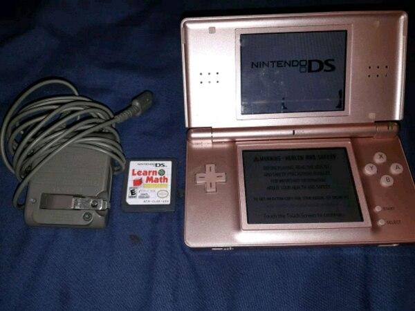 silver Nintendo DS with game cartridge