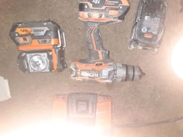 Ridgid hammer drill and flashlight comes with 3 batteries and charge