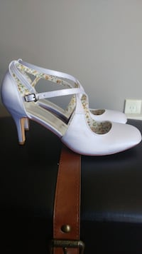 pair of white leather ankle-strap cone heeled shoes