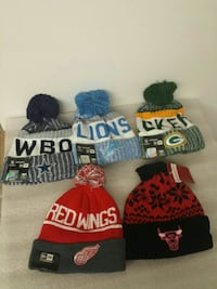 five assorted color ball knit caps