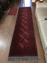 Red, black, and white area rug