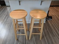 two brown wooden bar stools 43 km
