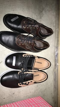 pair of black leather shoes Chestermere, T1X 0E1