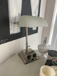 Table lamp with front plugs