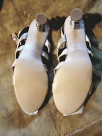 pair of brown leather coco channel sandals Bellview, 32526
