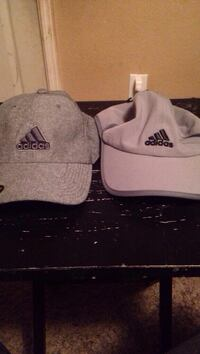 Two grey and pink adidas caps