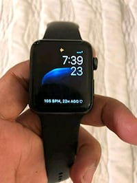 black Apple watch with black sports band 42 km