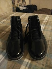 pair of black patent-leather derby boots