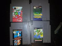 four Nintendo game cartridges Leduc, T9E