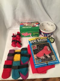 pairs of Dog boots and Dog slicker with boxes