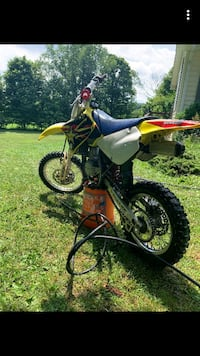 Yellow and black 2001 Suzuki 400 dirt bike w/ white brothers 434 big bore  kit  Comes with extra set of tires and filter  Need gone ASAP