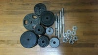 black barbell and weight plates 2401 mi