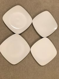 Four white ceramic plates 32 mi