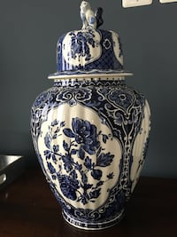 White and blue floral ceramic vase w/ removable top.