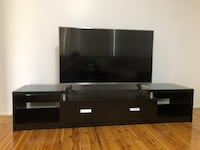black wooden TV stand with flat screen television بوسلي بارك, 2176