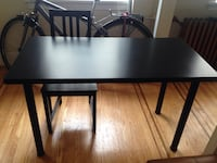 rectangular black wooden table with two chairs Vancouver, V6E 4A2
