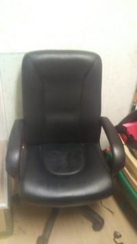 black leather padded rolling armchair VANCOUVER