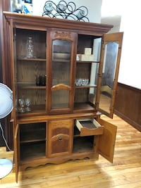 brown wooden framed glass display cabinet Lowell, 01850