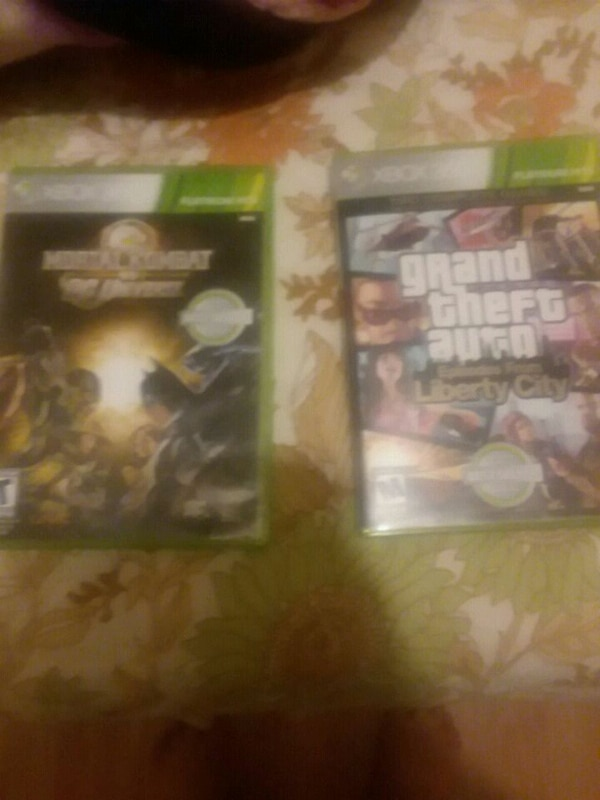 two Xbox 360 game