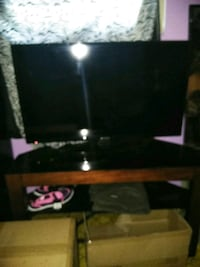 black flat screen TV with black wooden TV stand Las Vegas, 89183