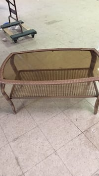 brown wicker framed glass top coffee table