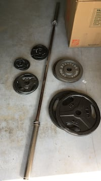 two black and gray barbell plates Woodstock, 30188